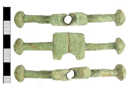 Cast cu-alloy bar from a now incomplete cast copper-alloy post-medieval purse, dating from the early 16th century.