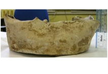 Cast lead-alloy tank dating from the later Saxon period.