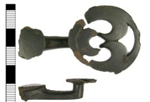 Large cast cu-alloy button and loop fastener dating from the Late Iron Age/ Roman period.